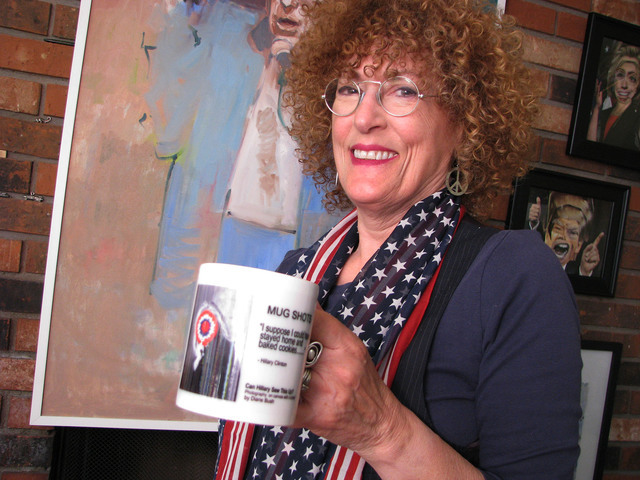 """Las Vegas photographer Diane Bush, curator of the election-themed exhibit """"Dishing It Out 2016 — Vanity Plates,"""" is shown in front of some of the works in her east valley home. A reception is  ..."""