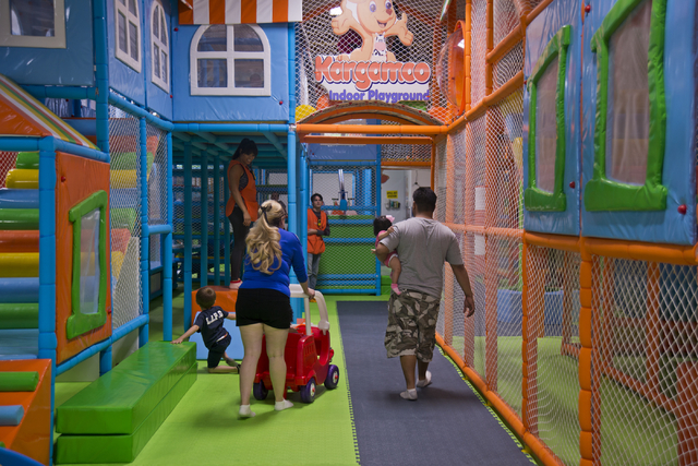 A family walks together inside Kangamoo Indoor Playground May 27, 2016. Daniel Clark/View