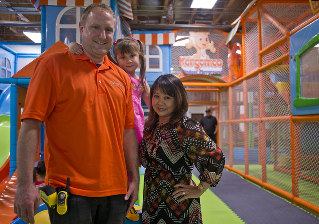 Owners Shawn and Mimi Wachter pose for a photograph with their daughter MaiLee inside their business, Kangamoo Indoor Playground, May 27, 2016. Daniel Clark/View