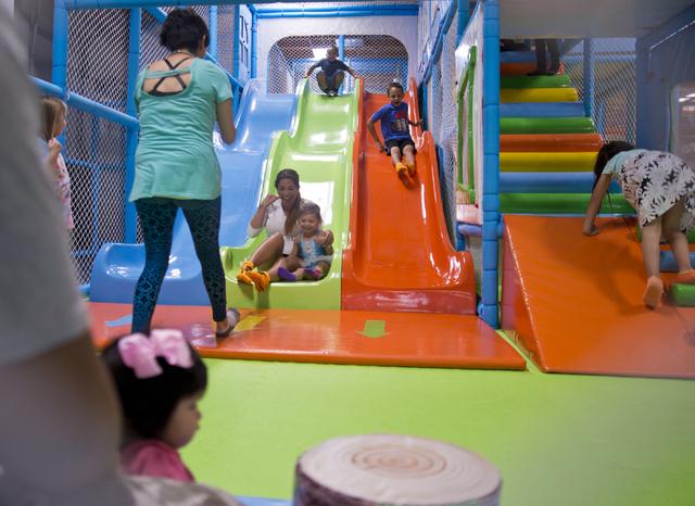 Parents and children play inside Kangamoo Indoor Playground May 27, 2016. Daniel Clark/View