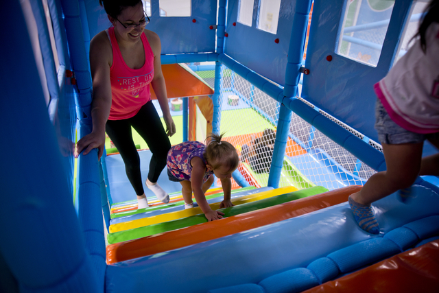Rachel McGee and her daughter Avery play together inside Kangamoo Indoor Playground May 27, 2016. Daniel Clark/View