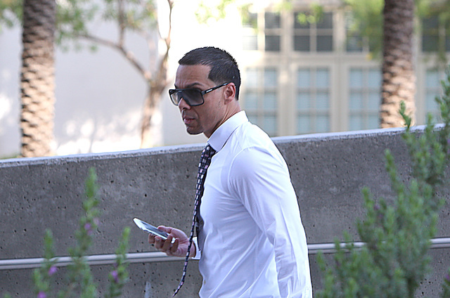 Ernesto Ramos, who pleaded guilty to extorting a prominent businessman, walks to the Lloyd George U.S. Courthouse for his sentencing on Thursday, June 30, 2016. (Bizuayehu Tesfaye/Las Vegas Review ...