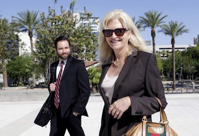 Ernesto Ramos' attorneys, Kathleen Bliss, right, and Jason Hicks walk to the Lloyd George U.S. Courthouse on Thursday, June 30, 2016. Ramos, not photographed, who pleaded guilty to extorting a pro ...