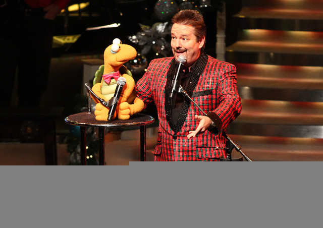 "Ventriloquist Terry Fator performs with puppet Winston the Impersonating Turtle during his new show, ""A Country Christmas,"" at the Terry Fator Theater at the Mirage in Las Vegas on Wednesday, Dec. ..."