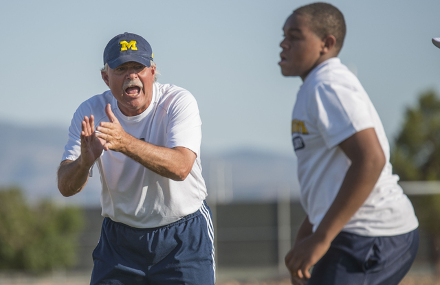 Don Brown, defensive coordinator at University of Michigan, coaches participants in the NV Showdown Football Camp at Chaparral High School in Las Vegas on Wednesday, June 22, 2016. (Jacob Kepler/L ...