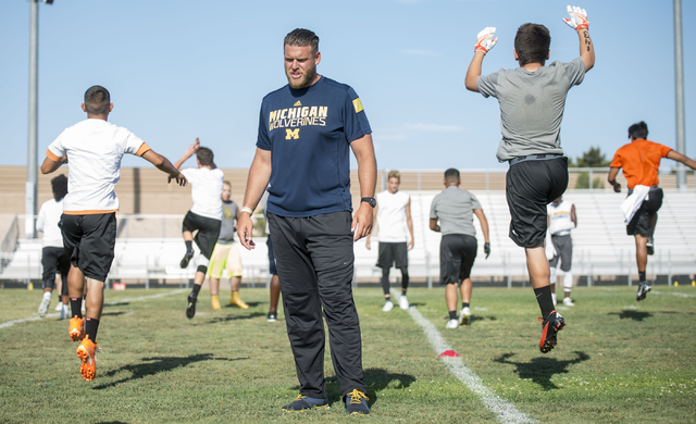 Mike Switzer, offensive analyst for the University of Michigan football team, coaches participants in the NV Showdown Football Camp at Chaparral High School in Las Vegas on Wednesday, June 22, 201 ...