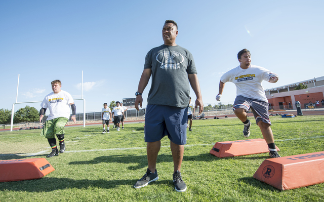 Ed Lamb, assistant coach at BYU, coaches participants in the NV Showdown Football Camp at Chaparral High School in Las Vegas on Wednesday, June 22, 2016. (Jacob Kepler/Las Vegas Review-Journal)