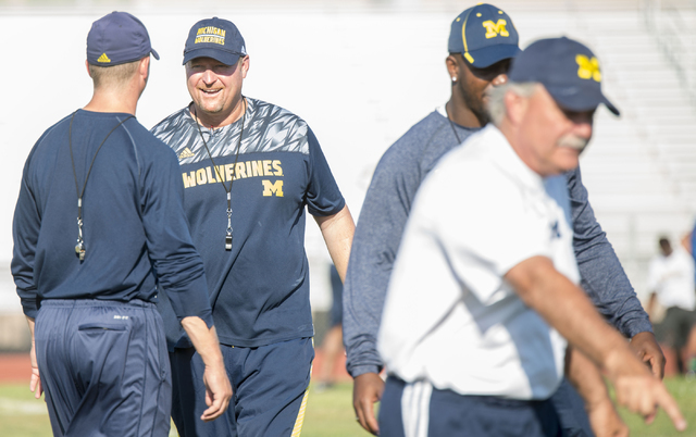 Tim Devno, offensive coordinator at the University of Michigan football team, coaches participants in the NV Showdown Football Camp at Chaparral High School in Las Vegas on Wednesday, June 22, 201 ...