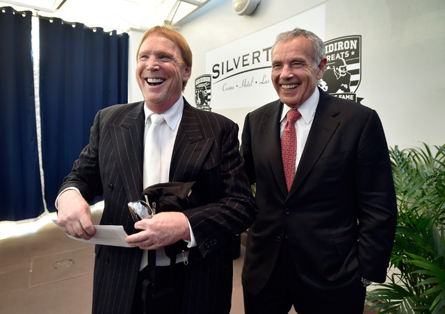 Oakland Raiders owner Mark Davis, left, and Edward Roski Jr., president and chairman for Majestic Realty Co. meet media members before the Gridiron Greats Hall of Fame Induction dinner at the Silv ...