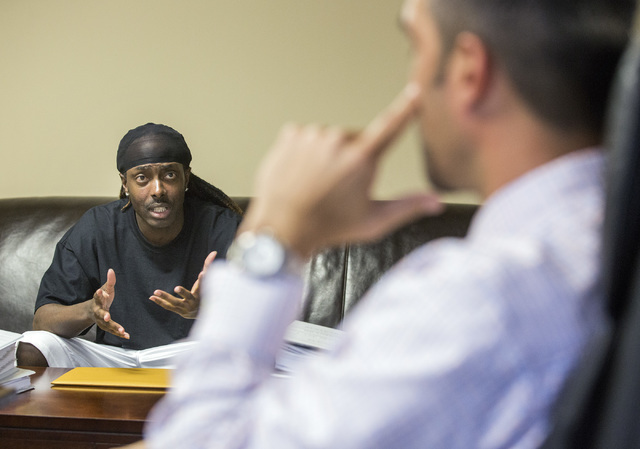 Robbery defendant Brian Wright, left, and his attorney  Lance Maningo talk about his federal court case at Bellon & Maningo law office, 732 S. Sixth St., on Tuesday, May 3,2016. A federal judg ...