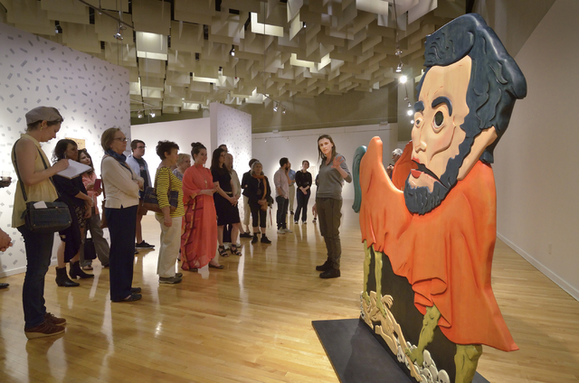 "Former UNLV artist-in-residence Erin Cosgrove, right, discusses her ""Urfather Lincoln"" during the recent opening of ""Five"" at UNLV's Barrick Museum. Bill Hughes/Las Vegas Review-Journal"