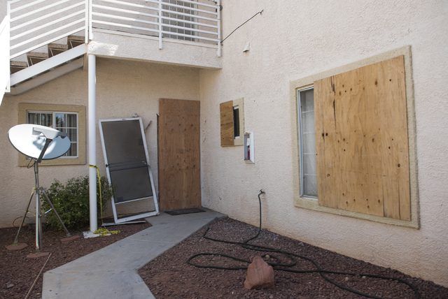 A unit is boarded up at Torrey Pines Condominiums in Las Vegas on Thursday, June 30, 2016. Neighbors said the unit is where three children were found shot dead Wednesday night. Police said a man k ...
