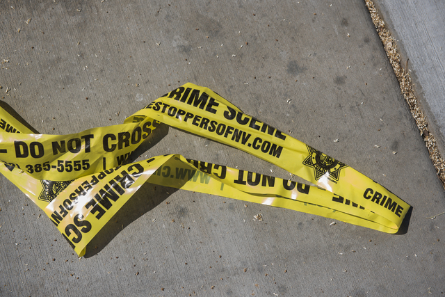 Crime scene tape is seen at Torrey Pines Condominiums in Las Vegas on Thursday, June 30, 2016. Three children were found shot dead in a unit Wednesday night. Police said a man killed his wife near ...