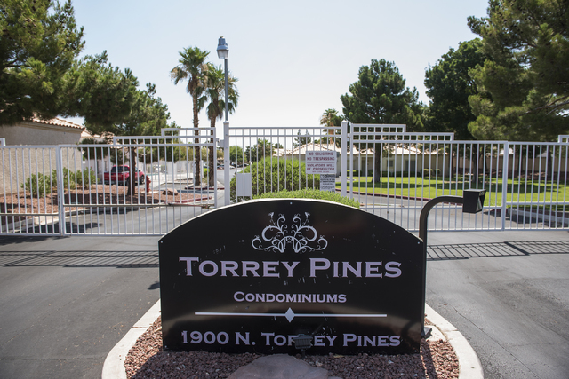 The entrance to Torrey Pines Condominiums in Las Vegas is seen Thursday, June 30, 2016. Three children were found shot dead in a unit Wednesday night. Police said a man killed his wife nearby, the ...