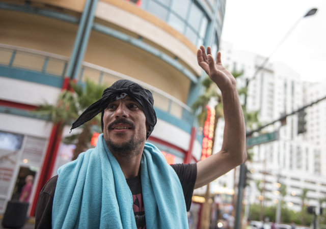 Las Vegas resident Lamar Starnes talks about the weather at the Fremont Street Experience in Las Vegas on Thursday, June 30, 2016. (Martin S. Fuentes/Las Vegas Review-Journal)