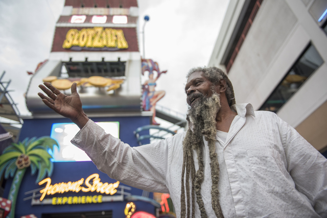 Busker Clyde Williams talks about the weather at the Fremont Street Experience in Las Vegas on Thursday, June 30, 2016. (Martin S. Fuentes/Las Vegas Review-Journal)