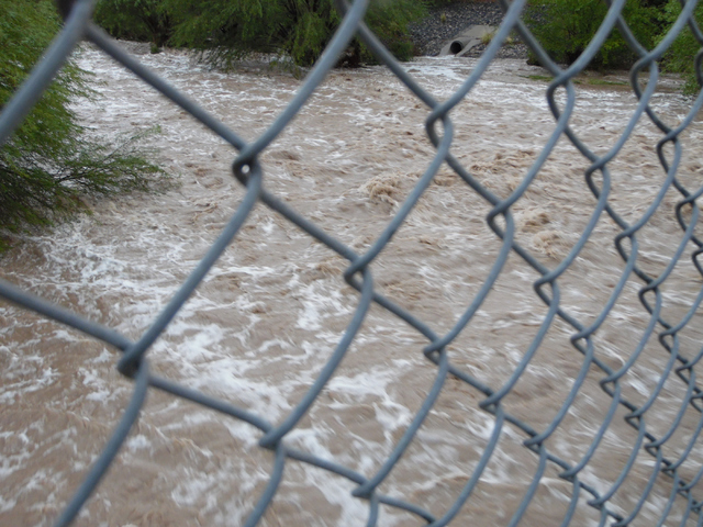 Flood water in Pittman Wash flows under Green Valley Parkway in Henderson Thursday, June 30, 2015. Natalie Burt/Special to the Las Vegas Review-Journal