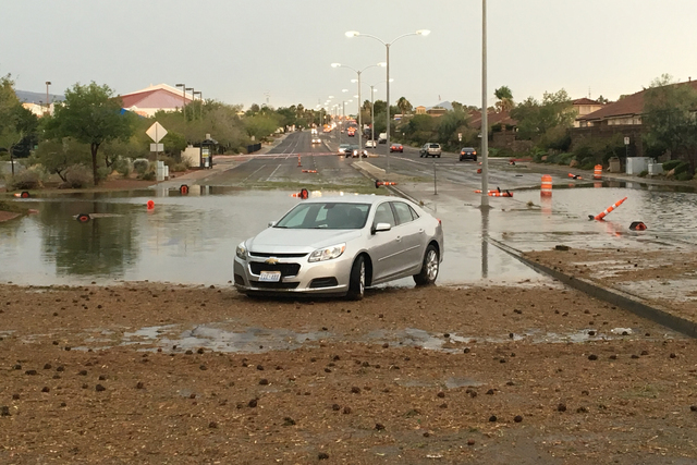 Pecos Road is closed between Robindale Road and Windmill Parkway in Henderson due to a disabled vehicle and flooding. (Bizuayehu Tesfaye/Las Vegas Review-Journal)