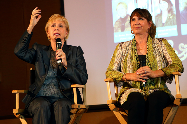 "Twins Teri Thorndike, left, and Sheri Mirault, both former ""Folies Bergere"" cast members, recall performing in the long-running Tropicana show during a panel discussion celebrating the launch of a ..."