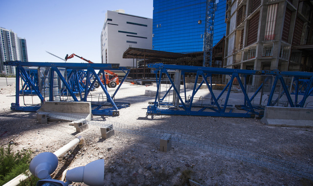 Sections of a crane at the site of the unfinished Fontainebleau Las Vegas on the north end of the Strip as seen Tuesday, May, 13, 2014. The crane at  68-story building is being removed after the p ...