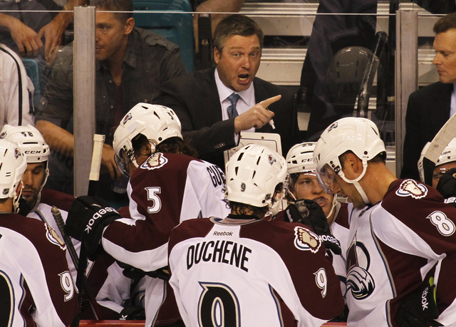 First-year Colorado Avalanche head coach Patrick Roy, middle, shouts instructions to his team as they take on the Los Angeles Kings during their Frozen Fury pre-season hockey game at the MGM Grand ...