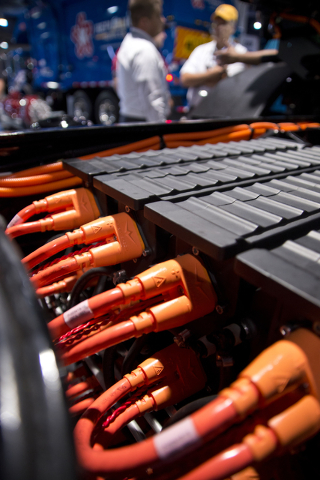 Battery packs are seen inside a Mack Trucks LR Model with an energy efficient Wrightspeed Powertrain Route 1000 electric drive system at the Waste Expo inside the Las Vegas Convention Center on Tu ...