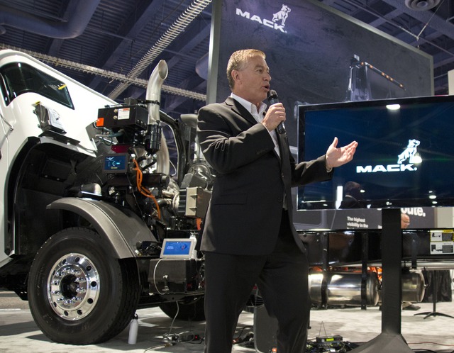 Vice President of Marketing for Mack Trucks, John Walsh talks about the LR Model truck fitted with an energy efficient Wrightspeed Powertrain Route 1000 electric drive system at the Waste Expo ins ...