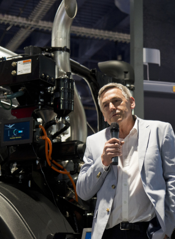 Ian Wright explains the features on a Mack Trucks LR Model fitted with an energy efficient Wrightspeed Powertrain Route 1000 electric drive system at the Waste Expo inside the Las Vegas Convention ...