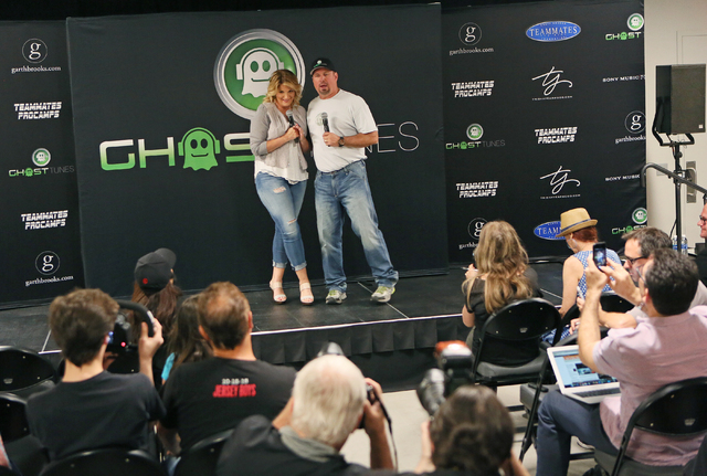 Country music star Garth Brooks, right, stands with wife and fellow performer Trisha Yearwood while answering questions about the duo's Garth Brooks World Tour with Trisha Yearwood during a news c ...