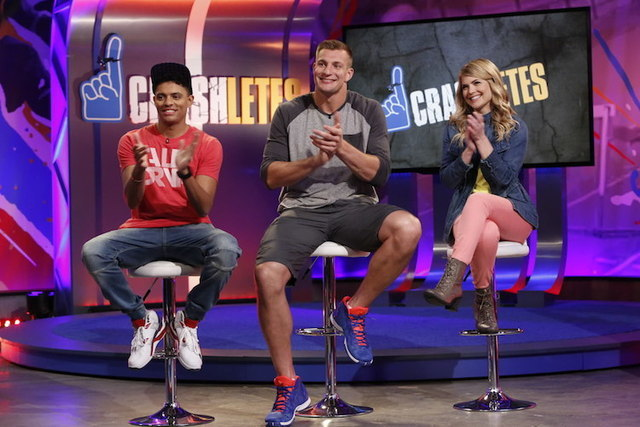 "Rob Gronkowski, center, applauds during a taping of ""Crashletes,"" in Los Angeles, with co-hosts Brandon Broady, left, and Stevie Nelson on the show debuting July 5, 2016 on Nickelodeon. (Nickelode ..."