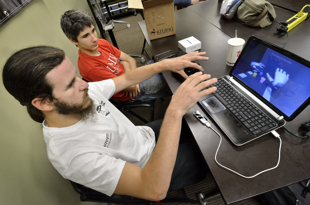 Camren Wakefield, left, and Cooper Madrazo test and explore a Leap Motion Controller at the SYN Shop at 1075 American Pacific Drive in Henderson on Saturday, June 18, 2016. (Bill Hughes/Las Vegas  ...