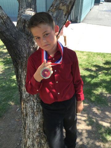 "Ty Whitman, 11, shows a leadership medal June, 1, 2016. Whitman suffered neck puncture woundpuncture wound nicked his carotid artery that could have burst. Photo by Maria ""Jini"" Whitman"