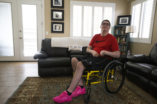 Giulian Grasso, 19, poses for a portrait at his home on Thursday, June 16, 2016, in Henderson. Grasso is paralyzed on his left side of the body after a skateboarding accident while a high school s ...