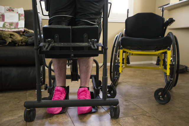 Giulian Grasso, 19, stretches at his home on Thursday, June 16, 2016, in Henderson. Grasso is paralyzed on his left side of the body after a skateboarding accident while a high school sophomore in ...