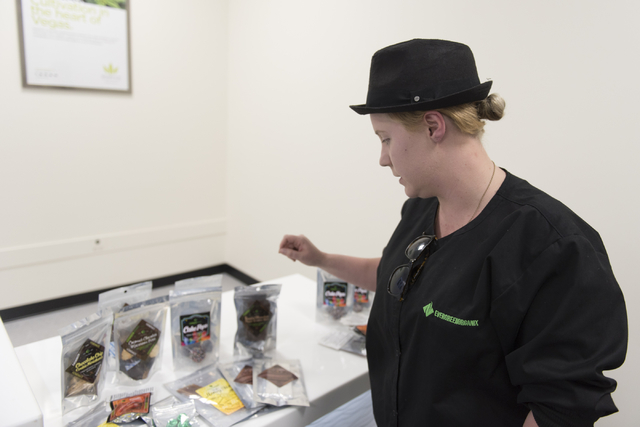 Madeline Rubidoux, chocolatier and chef with Evergreen Organix, shows some of the Evergreen Organix products for sale at the Essence Cannabis Dispensary in Henderson June 15, 2016. Jason Ogulnik/View