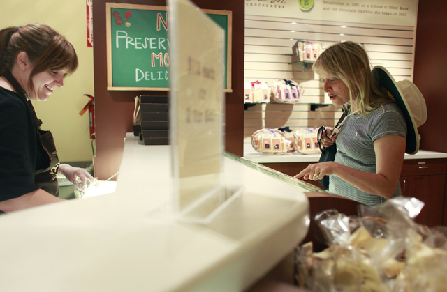 Tammy Jo French, left, helps Amy Kierce of Acton, Mass., with her chocolate selection at Ethel M Chocolates in Henderson, Nev.  (Alyssa Orr/Las Vegas Review-Journal)