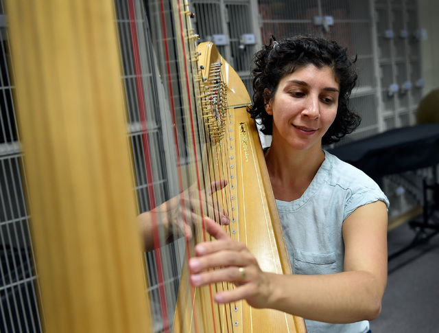 Cathryn Daniels plays her harp during a Henderson Symphony Orchestra rehearsal at Greenspun Junior High School May 2, 2016. The orchestra is set to perform live music to accompany the silent movie ...