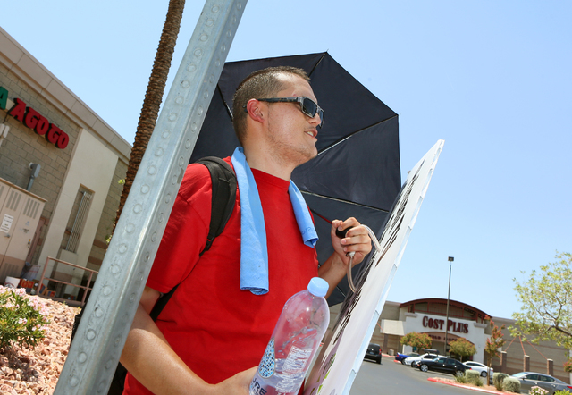Sign spinner and Motivational Systems advertising associate Richard Thomas stands on the sidewalk near businesses along Rainbow Boulevard north of Lake Mead Boulevard on Monday, June 20, 2016, in  ...