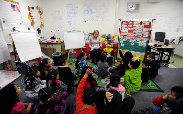 Kimberly Grettum, center, child life specialist at UMC sits with a stuffed monkey in Elizabeth Cox's first grade classroom at Rose Warren Elementary School on Tuesday, Feb. 18, 2014. (David Becker ...