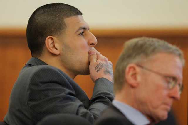 Former New England Patriots football player Aaron Hernandez and his attorney Charles Rankin listen as prosecution witness Alexander Bradley is questioned by the prosecution without the jury presen ...
