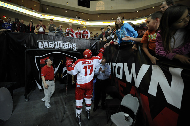 Las Vegas Wranglers forward Adam Huxley, the last player to walk off the ice after the Wranglers 3-2 loss to the Alaska Aces during of game 4 of the first round of the 2014 ECHL Kelly Cup playoff  ...