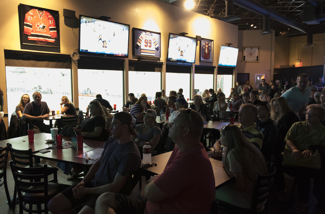 Hockey fans gather at Brooksy's Bar & Grill prior to a conference in which the NHL's Board of Governors announced approval of an expansion franchise in Las Vegas Wednesday, June 22, 2016. Jaso ...