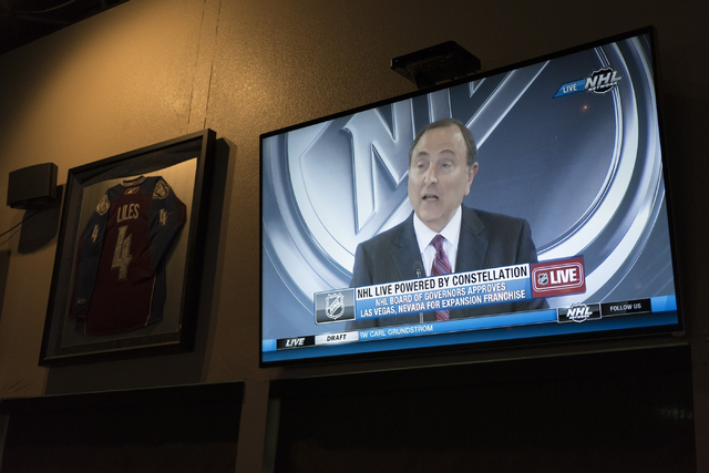 NHL Commissioner Gary Bettman is seen on a television screen during a conference in which the NHL's Board of Governors approved an expansion franchise in Las Vegas at Brooksy's Bar & Grill Wed ...