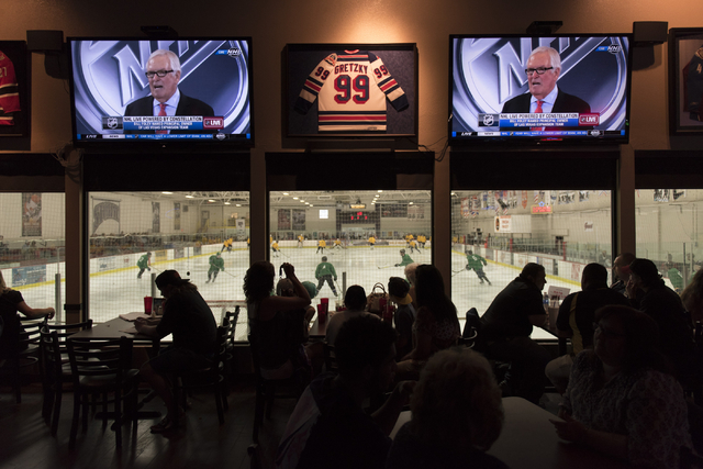 Bill Foley, principal owner of the Las Vegas NHL expansion franchise, is seen on television screens during a conference in which the NHL's Board of Governors approved an expansion franchise in Las ...