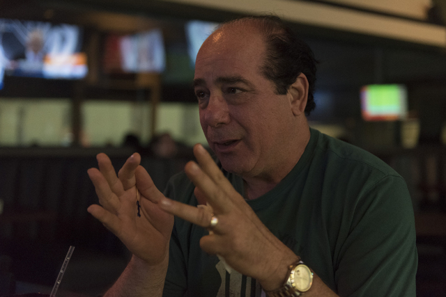 Joe Blau speaks with a reporter at Brooksy's Bar & Grill following a conference in which the NHL's Board of Governors approved an expansion franchise in Las Vegas Wednesday, June 22, 2016. Jas ...