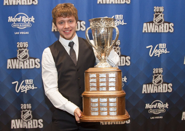 Chicago Blackhawks' Artemi Panarin, of Russia, holds the Calder Trophy after winning the award at the NHL Awards show held at the Hard Rock Hotel and Casino in Las Vegas on Wednesday, June 22, 201 ...