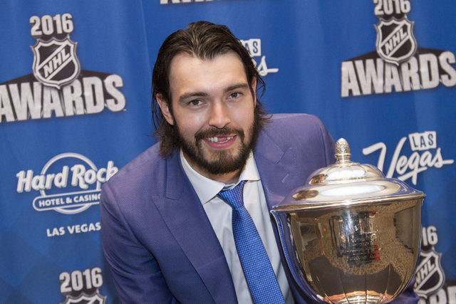 Los Angeles Kings' Drew Doughty holds the Norris Trophy after winning the award at the NHL Awards show held at the Hard Rock Hotel and Casino in Las Vegas on Wednesday, June 22, 2016. Richard Bria ...