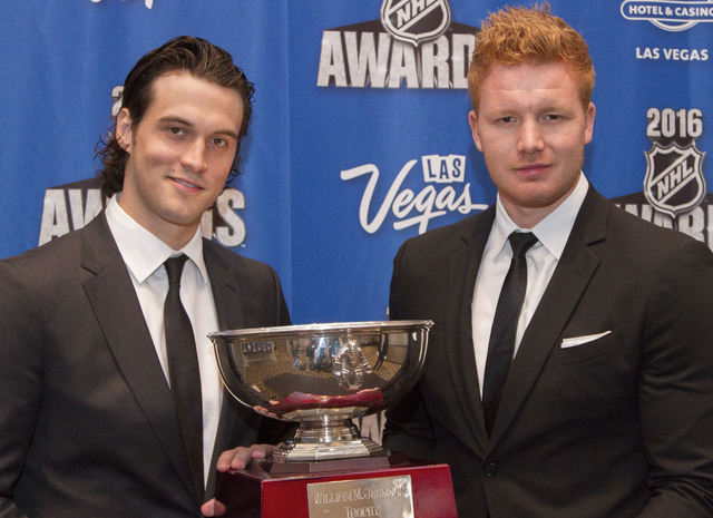Anaheim Ducks goalie John Gibson, left, and goalie Frederik Andersen pose with the William M. Jennings Trophy after winning the award at the NHL Awards show held at the Hard Rock Hotel and Casino  ...