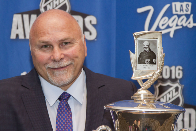 Washington Capitals head coach Barry Trotz poses with the Jack Adams Award after winning the award at the NHL Awards show held at the Hard Rock Hotel and Casino in Las Vegas on Wednesday, June 22, ...