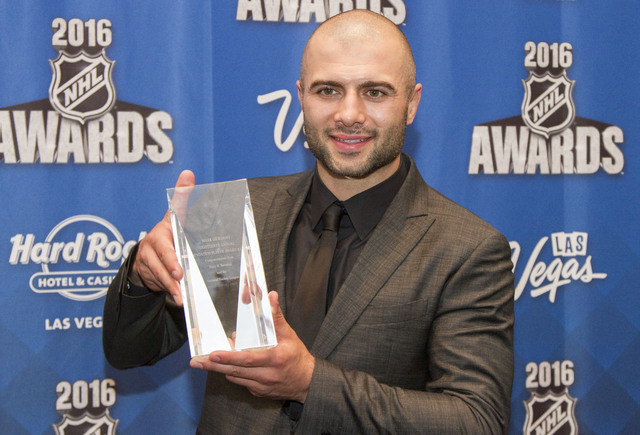 Calgary Flames' Mark Giordano holds the NHL Foundation Player Award after winning the awards at the NHL Awards show held at the Hard Rock Hotel and Casino in Las Vegas on Wednesday, June 22, 2016. ...